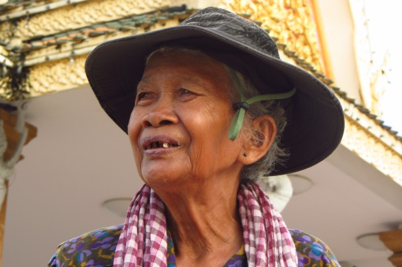 This old woman walks around the riverside in Phnom Penh every day with a scale, asking people if they'd like to check their weight.