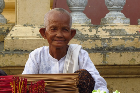 This old Yoda-looking woman sits outside a temple at the Phnom Penh riverside selling flowers and incense everyday.