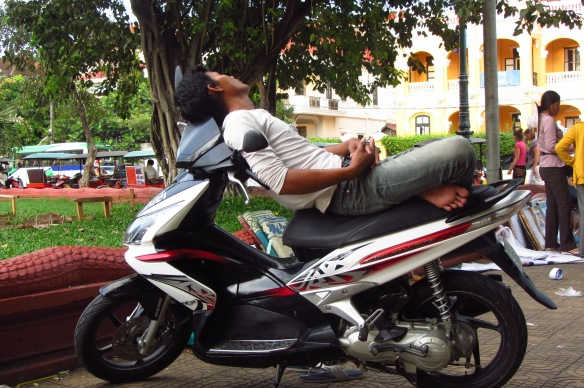 A moto driver taking a late afternoon snooze in Phnom Penh.