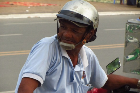 A moto driver waits for business in Phnom Penh.