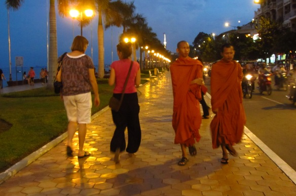 Mom Tina and Tori cross paths with a couple of monks in Phnom Penh.
