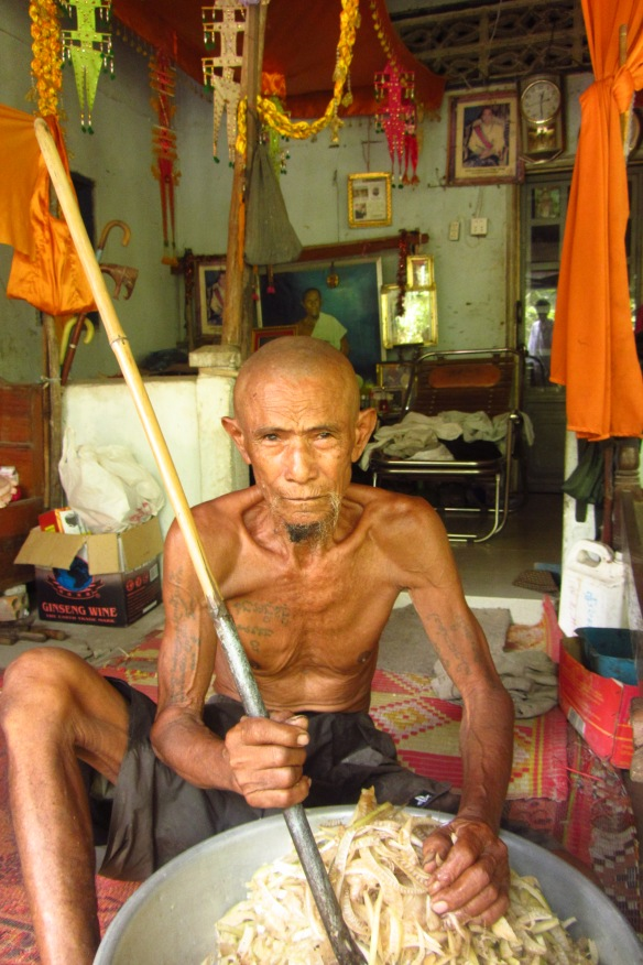 A medicine man at his home, which doubles as a clinic in Kampong Speu, Cambodia.