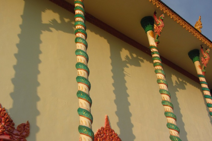 Shadows of Garudas playing on the temple walls in Kampong Speu Province