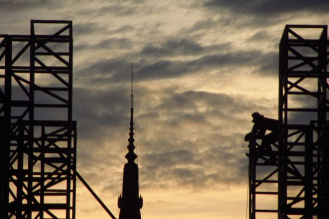 Sunset silhouette of recently deceased King Sihanouk's stupa construction.