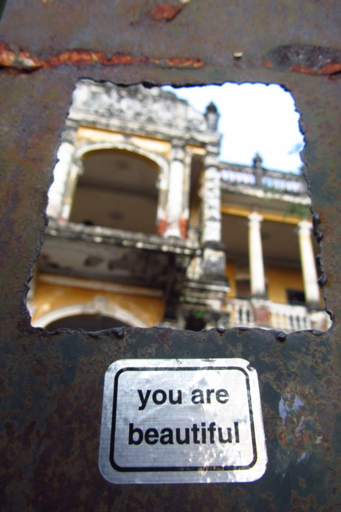Never forget it. Sticker posted outside a beautiful abandoned building in Phnom Penh.