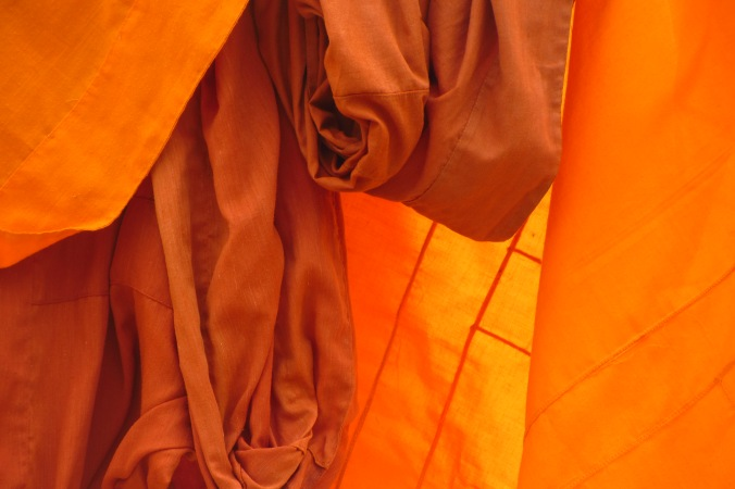 Close-up of a monk's robe out to dry in the mid day heat.