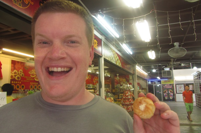 My funny hubby, about to regrettably eat a durian cream filled puff in Melaka :D