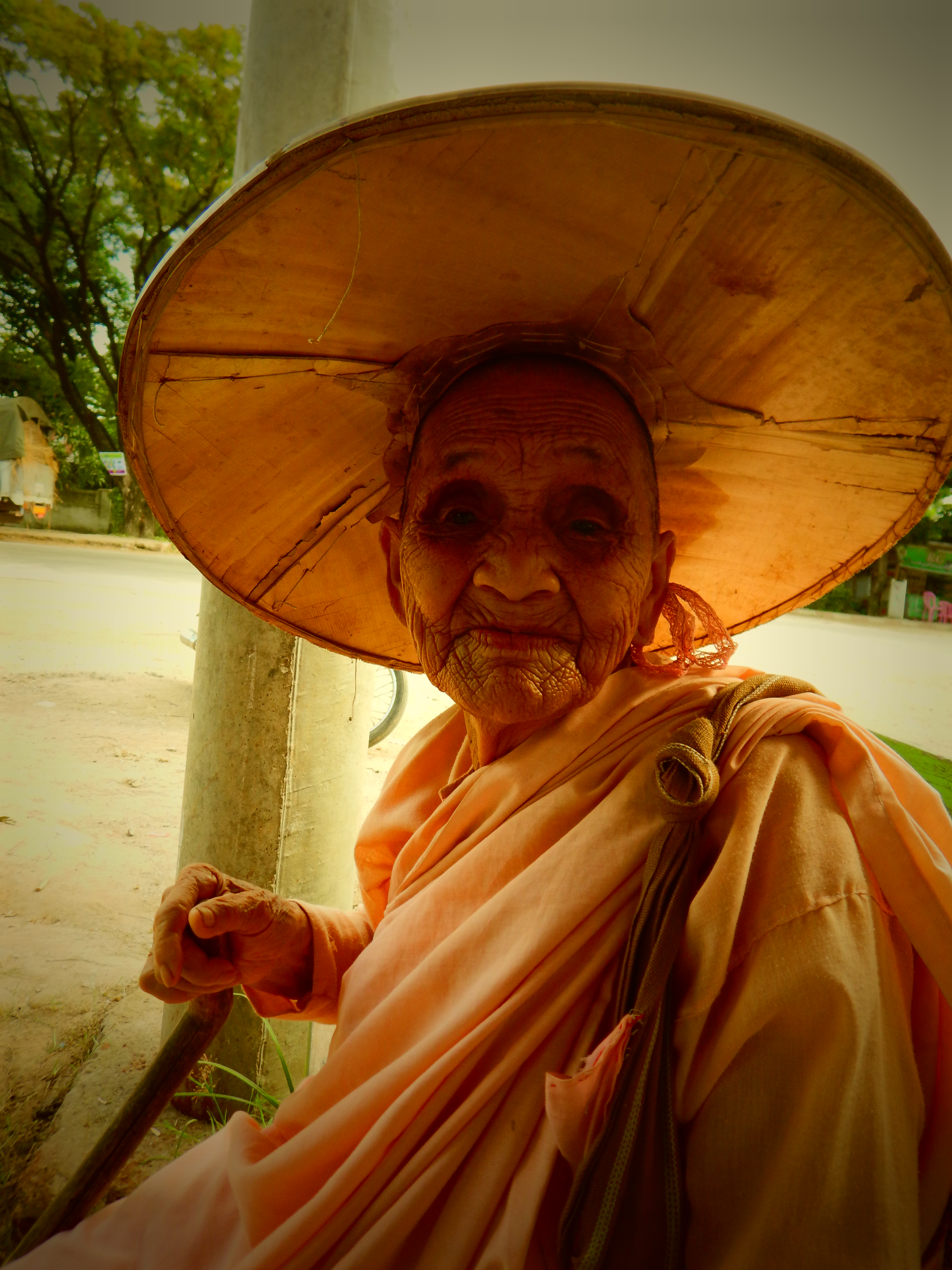 I met this 90 year old nun as she was walking along the road in the early morning collecting alms. I gave her a donation and requested to take her photo. She asked me for a copy of it, and that's how I was invited into her monastery.